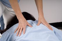 hands on back during massage